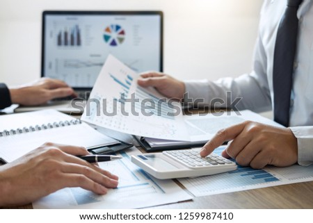 Executive business people team brainstorming on meeting to conference planning investment project working and strategy of business making conversation with partner, financial and accounting concept. #1259987410
