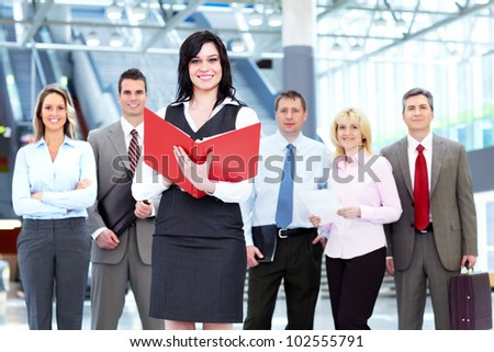 Executive business woman and a group of business person at the hall.