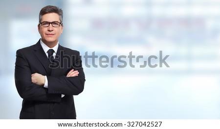 Executive businessman over blue banner background.