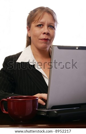 Executive professional business woman working on laptop computer