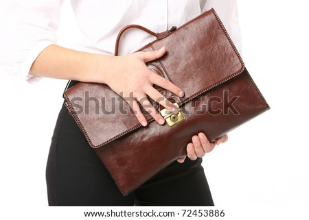 executive woman holding a bag - stock photo