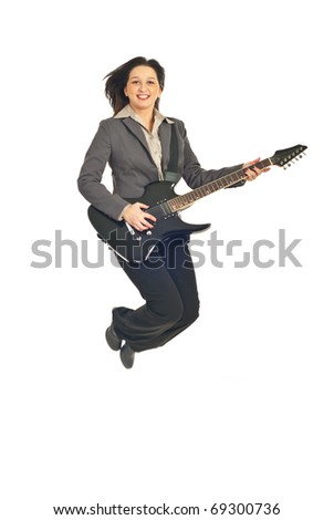 Executive woman jumping with guitar isolated on white background