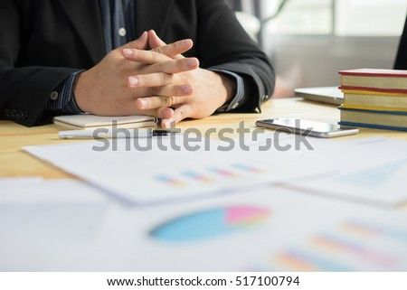 Executives listening to the opinion of the team.Young successful business people interacting, discussing and sharing ideas in bright modern office with clenched fists. Business success concept