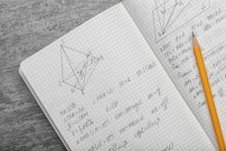 Exercise book with math homework, closeup