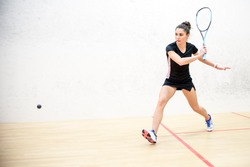 Exercise on the backhand in squash, girl athlete