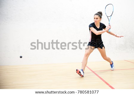 Exercise on the backhand in squash, girl athlete Сток-фото ©