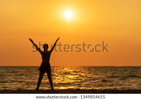 Exercise spirit lifestyle mind woman peace vitality, silhouette outdoors on the Sea sunrise, relax and freedom vital abstract. Healthy and Sport Concept
