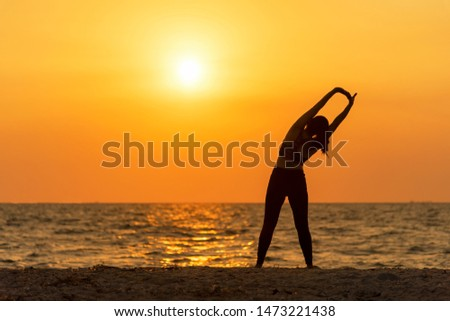 Exercise spirit lifestyle mind woman peace vitality, silhouette outdoors on the Sea sunrise, relax vital abstract. Healthy and Sport Concept