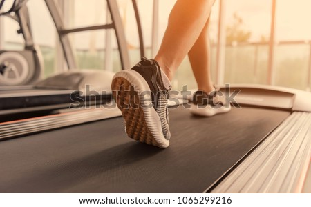 Exercise treadmill cardio running workout at fitness gym of woman taking weight loss with machine aerobic for slim and firm healthy in the morning.Show of running shoes, rubber floor, softness,  #1065299216