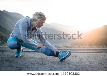 Exercising adult woman outdoors. Sports and recreation #1110108383