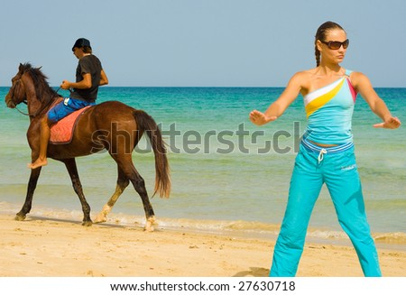 Exercising girl, riding horseman