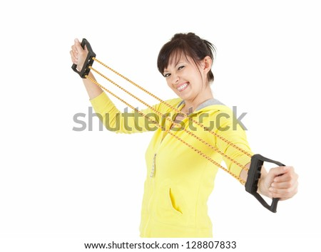 exercising young woman with expander, white background