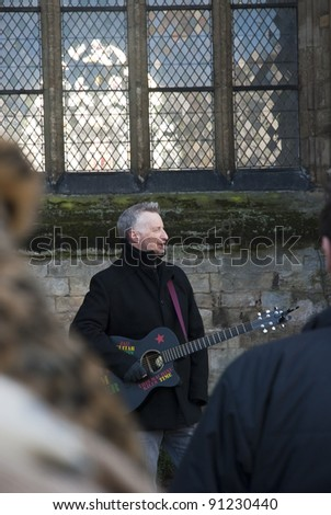 EXETER - DECEMBER 16: Billy Bragg seen through the audience at the Occupy Exeter camp on Exeter Cathedral green Camp on December 16, 2011 in Exeter, UK