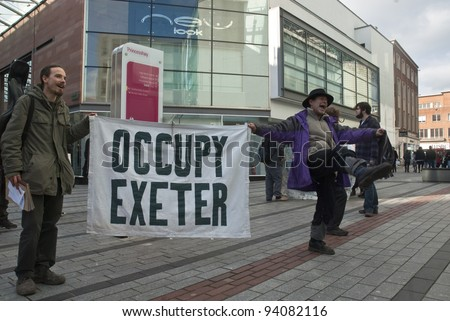 EXETER - JANUARY 28:Occupy Exeter activists outside Exeter branches of Topshop  on January 28, 2012 in Exeter, UK