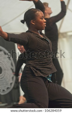 EXETER - JUNE 3: Dancer from State of Emergency Dance Company perform live on the Global Community Stage at the Exeter Respect Festival on June 3, 2012 in Exeter, UK