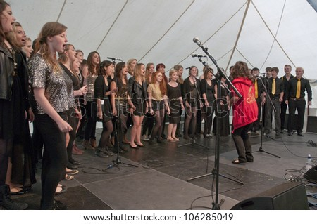 EXETER - JUNE 3: Singers from University of Exeter Soul Choir perform live on the Global Community Stage at theExeter Respect Festival on June 3, 2012 in Exeter, UK