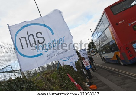 EXETER - MARCH 7: An NHS Together flag flaps in the wind during the NHS reform protest outside the Royal Devon & Exeter Hospital on March 7, 2012 in Exeter, UK