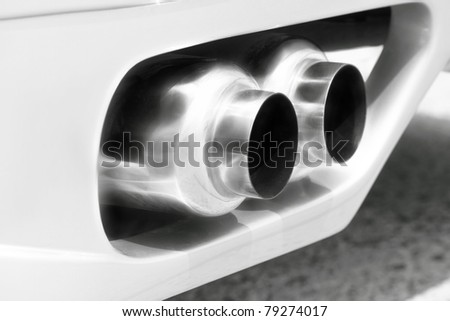 exhaust of a sports car- pollution concept