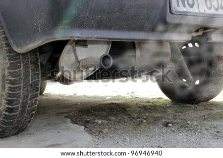 exhaust pipe of an old red car - stock photo
