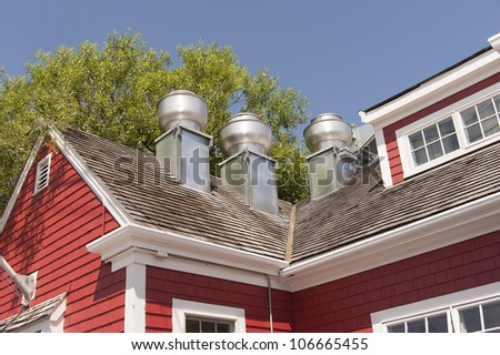 exhaust system vents on roof of a restaurant