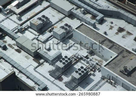 Exhaust vents of industrial air conditioning and ventilation units. Building roof top in Liverpool, UK.