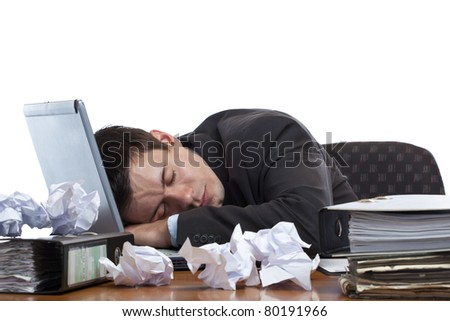 Exhausted and tired businessman sleeping in office at laptop. Isolated on white background.