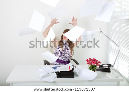 Exhausted business woman with annoying documentation