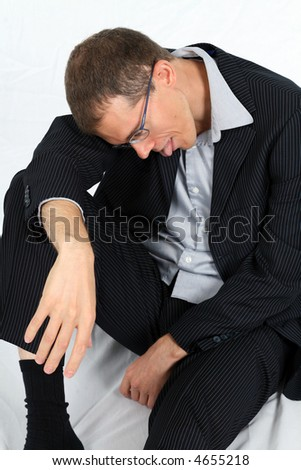 exhausted businessman in suit with tongue hanging out