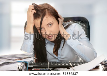 Exhausted female filling out tax forms while sitting at her desk. Isolated