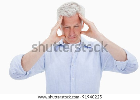 Exhausted man having a headache against a white background