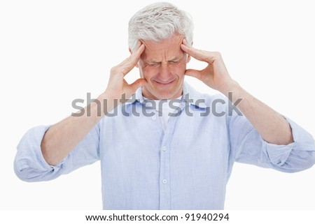 Exhausted man having a strong headache against a white background