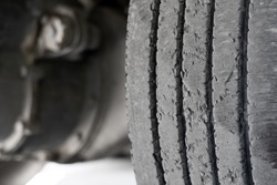 Exhausted truck tread old damaged and worn black tire tread. Change time. Tire tread problems and solutions concept