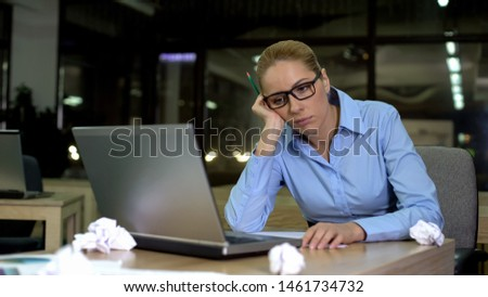 Exhausted woman lacking business ideas, working extra hours in office, burnout