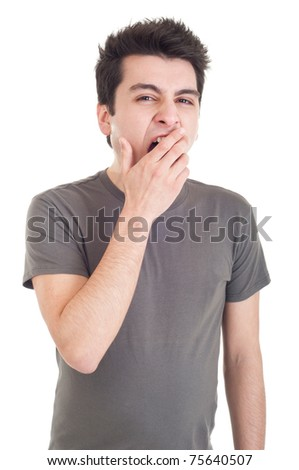 exhausted young man yawning isolated on white background
