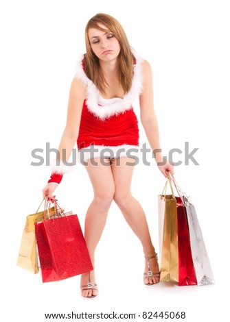 exhausted young woman in santa suit carrying shopping bags
