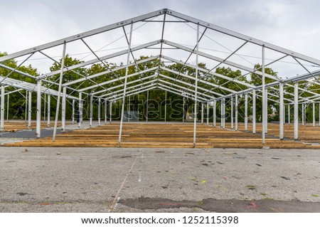 Exhibition construction of a regional fair, tent construction, aluminum poles and squared timber for tent floor in the fair tents, view over the exhibition grounds