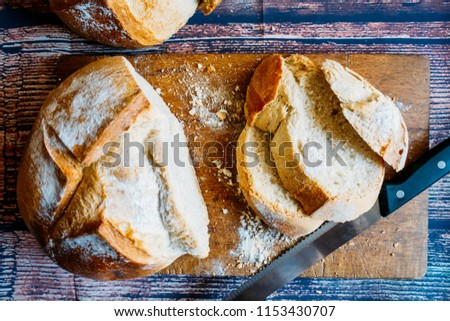 Exhibition of rustic bread sliced on a table. #1153430707