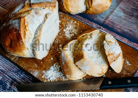 Exhibition of rustic bread sliced on a table. #1153430740