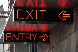 Exit and entry neon signs in Christchurch, New Zealand