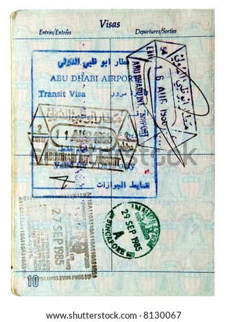 exit and entry stamps and a Visa stamp inside a passport