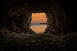 Exit from the cave overlooking the evening sea.