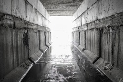 Exit from the drainage sewage rectangular tunnel. Concrete Drainage Pipe, collector of city sewage system