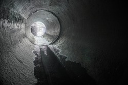 Exit from the drainage sewage tunnel pipe. Concrete Drainage Pipe, collector of city sewage system