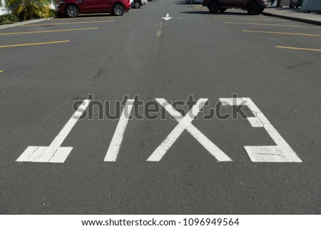 Exit Sign in Parking Lot #1096949564