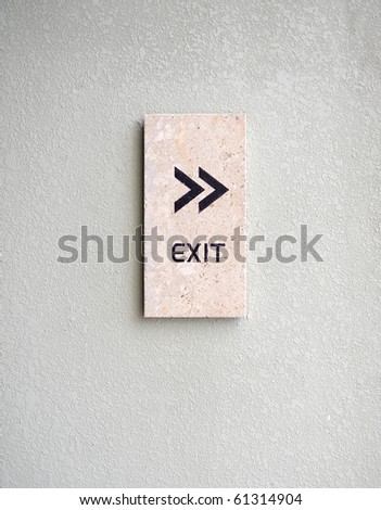 Exit sign on stone plate