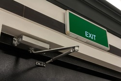 Exit sign on the door. Close up Exit sign on door in the building. Evacuation exit.