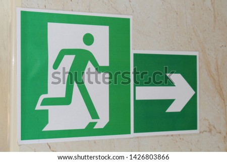 Exit sign with running man icon and arrow #1426803866
