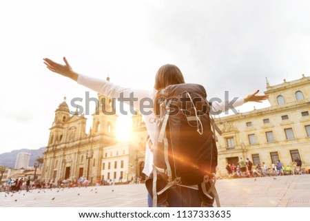 Exited backpacker with rised arms in Bogota - Shutterstock ID 1137333635