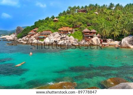 Exotic Bay with hotel villas. Cear emerald sea. Stok fotoğraf ©