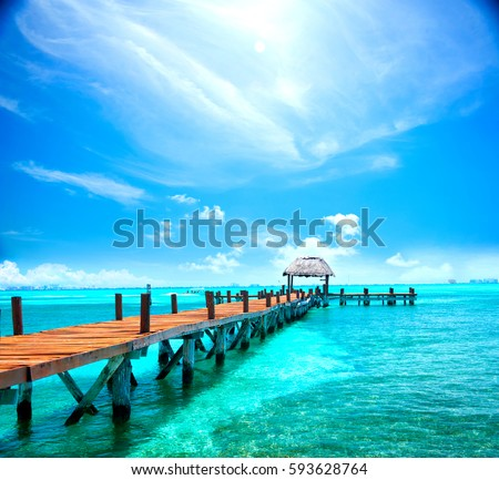 Shutterstock Exotic Beach, Paradise. Travel, Tourism and Vacations Concept. Landscape of Tropical Resort. Jetty near Cancun, Mexico